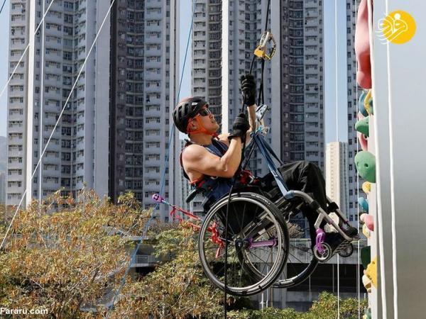 (تصاویر) بالارفتن یک معلول با ویلچر از آسمانخراش